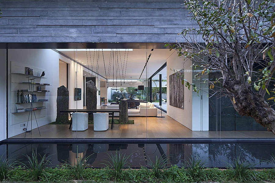 Reflective water body gives the home the appearance of floating on water