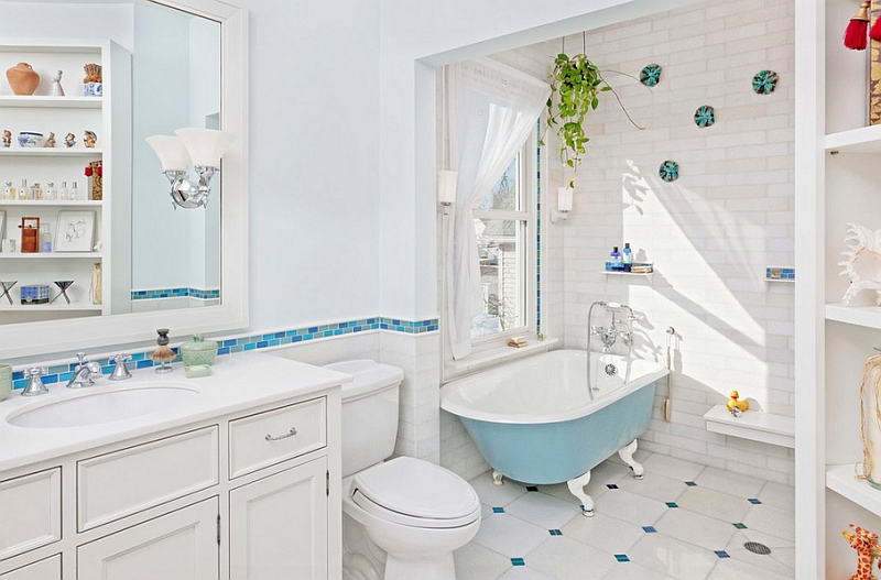Relaxing and stylish bathroom in blue and white with a colorful bathtub