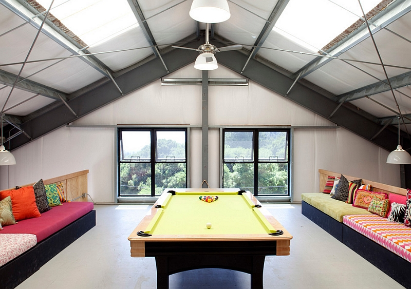 Restrained use of color in the stylish attic game room How To Transform Your Attic Into A Fun Game Room