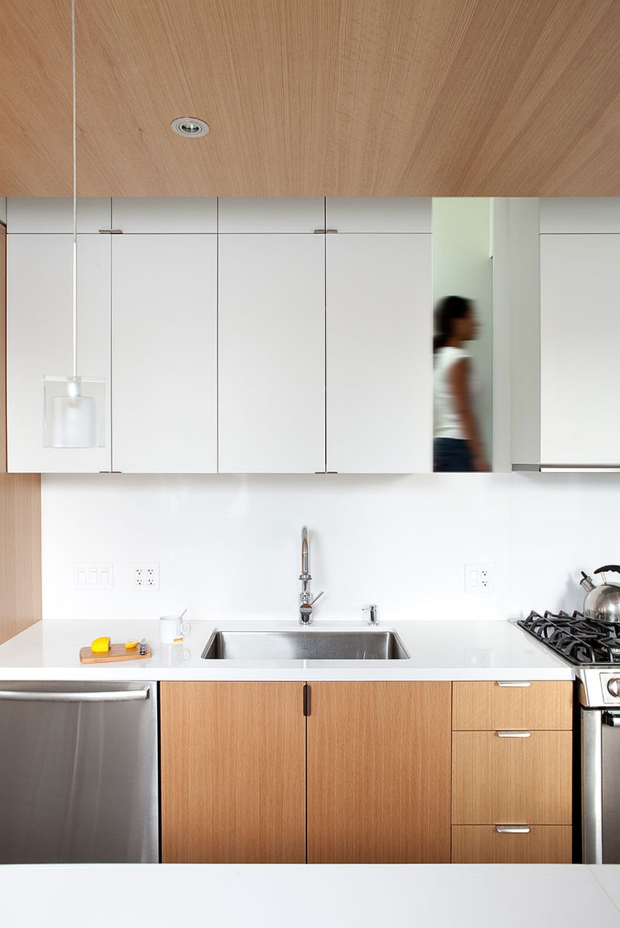 Bright and beautiful urban renovation unites two for Sleek modern kitchen cabinets