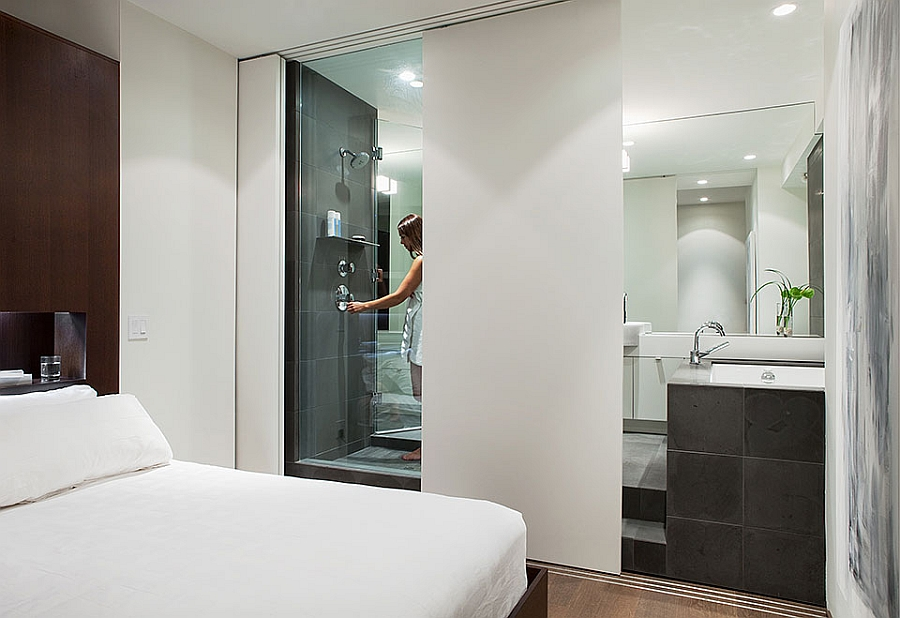 Sliding panel offers privacy for the glass bath