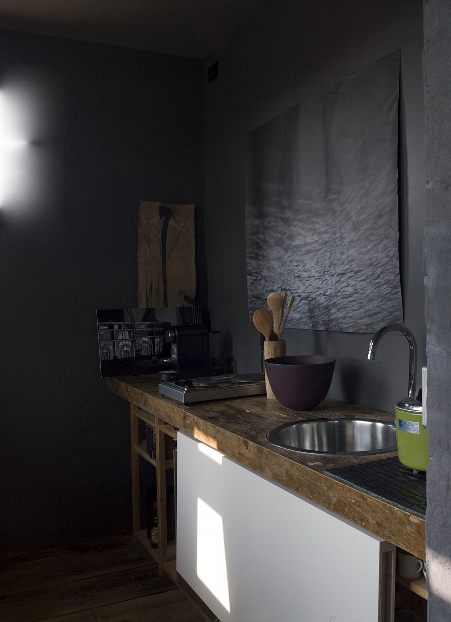 Small kitchen area that is rustic
