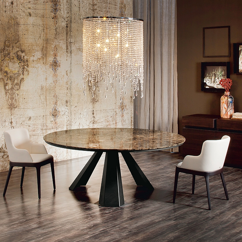 Small round dining table with a brilliant chandelier above