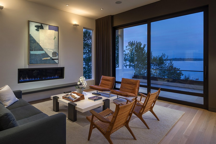 Spacious living area with modern fireplace Elegant Seattle Home Enthralls With Spectacular Lake Washington Views
