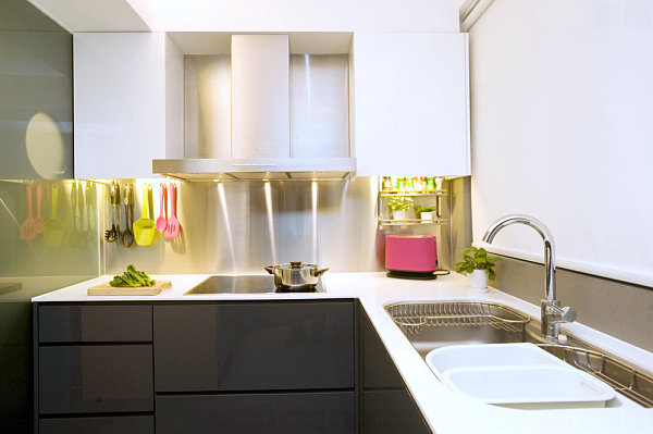 Stainless steel backsplash in a kitchen with colorful accents