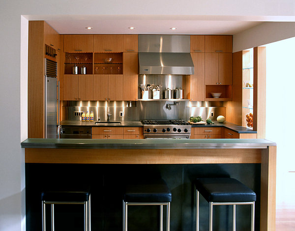 Stainless steel backsplash in a warm-toned kitchen