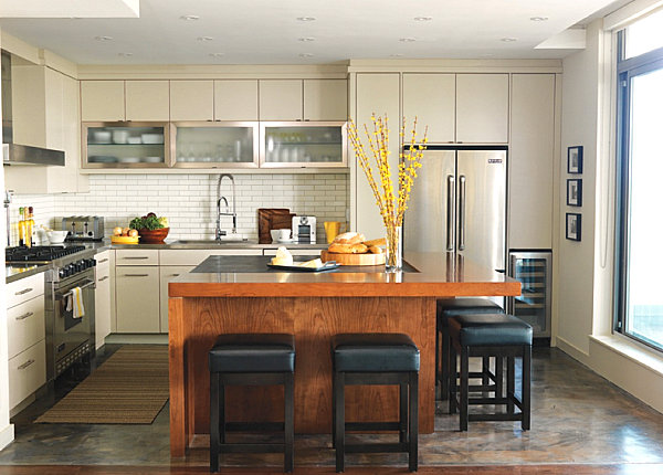 Stainless steel countertops in a white kitchen with warm details