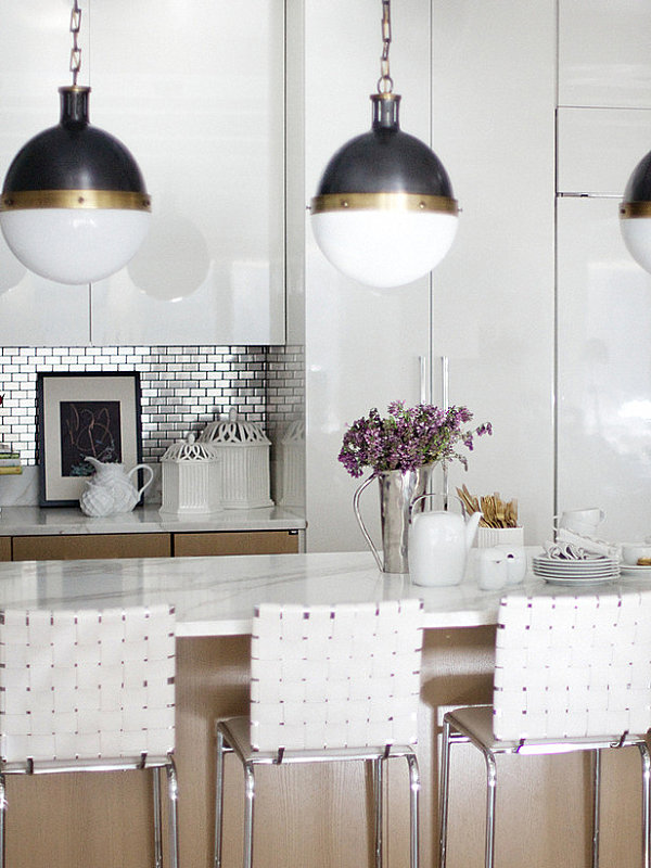 ... steel tile backsplash in a white kitchen with metallic accents