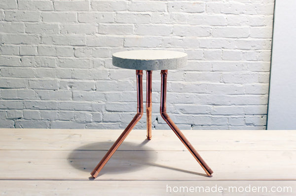 Stool made from concrete and piping Add A Touch Of Comfort And Style To Your Interior With A DIY Stool