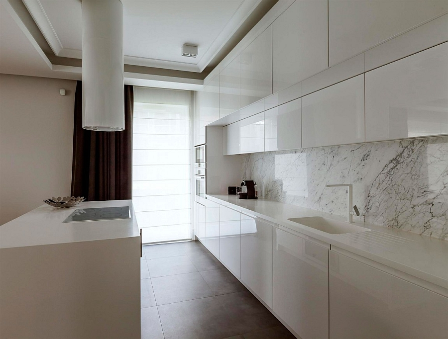 Super sleek modern kitchen in white with a marble backsplash