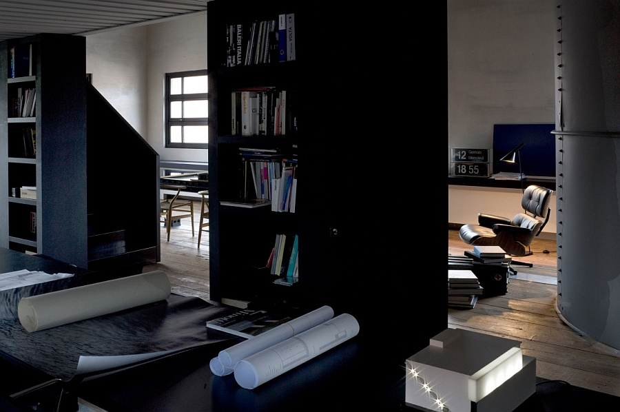 Tall shelves and the Eames Lounger grace the interior