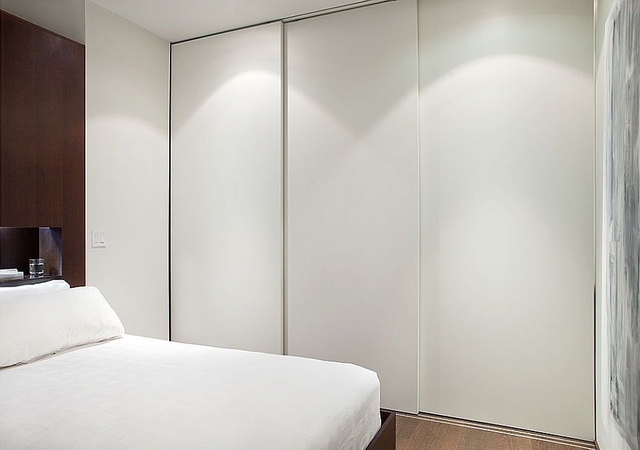 Three sliding opaque panels to close off the bathroom from master bedroom