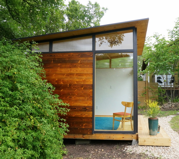 Tiny house with floor-to-ceiling windows