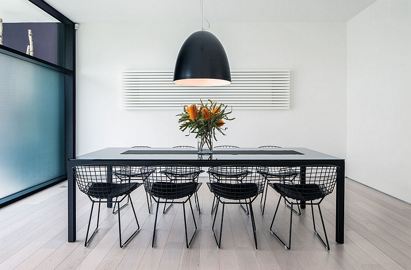 Ultra modern dining room with oversized light fixture