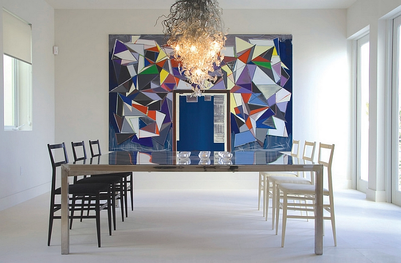 Wall art and chandelier enliven the minimal dining room