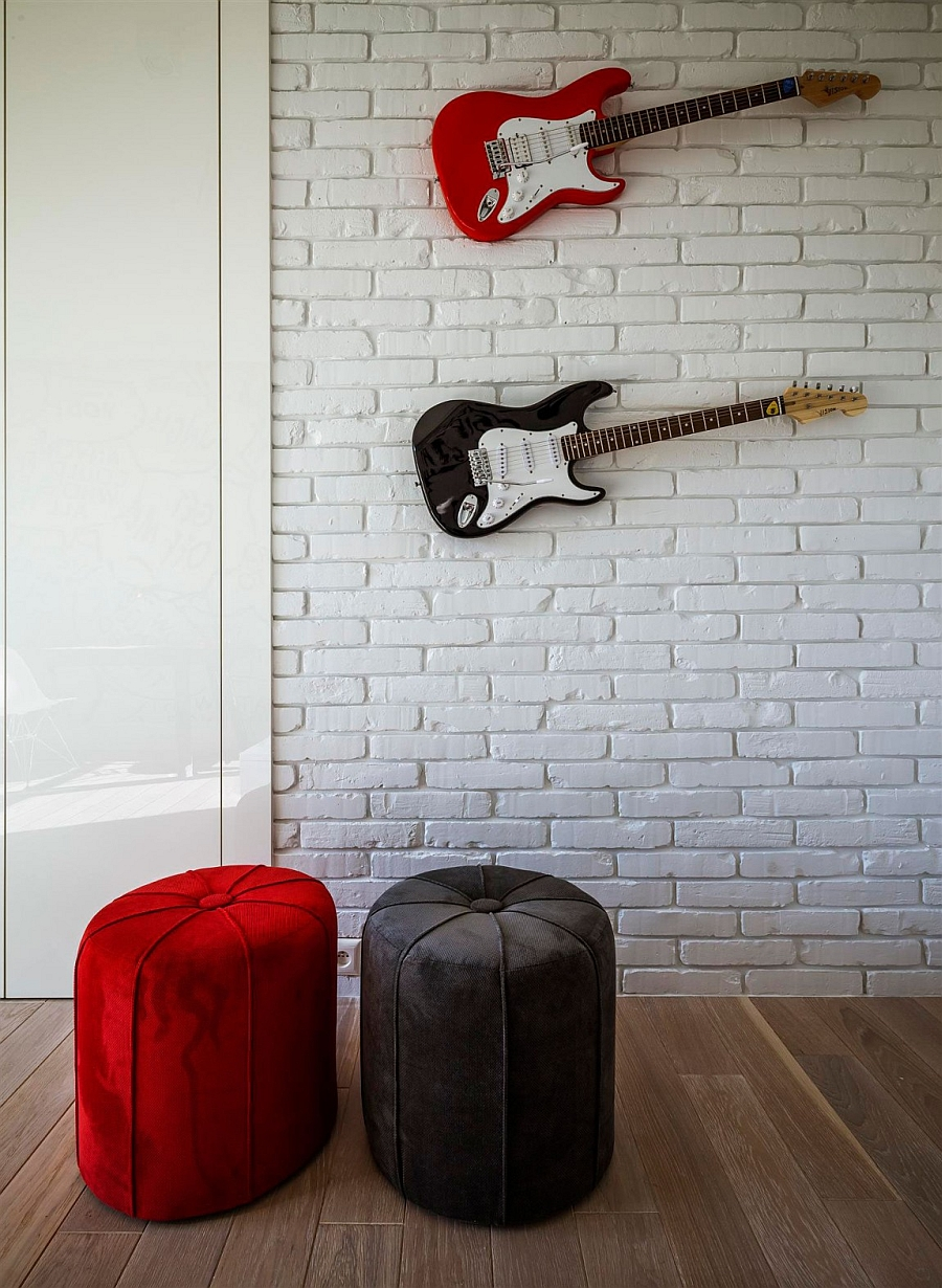 Wall-mounted guitars in the kids' bedroom
