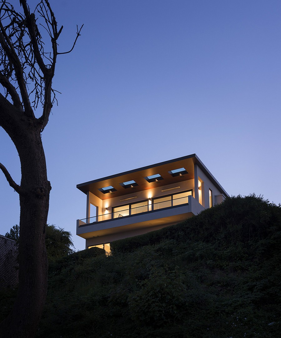 Warm lighting helps define facade of the modern home