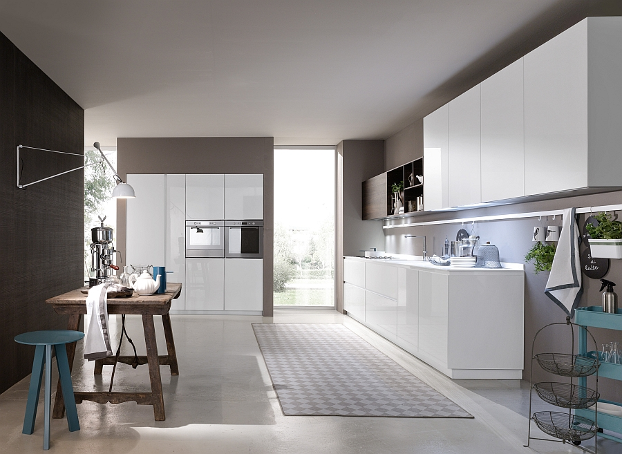 White glossy lacquered base units and Corian glacier white worktop in the kitchen