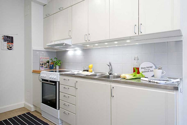 White kitchen with stainless steel countertops