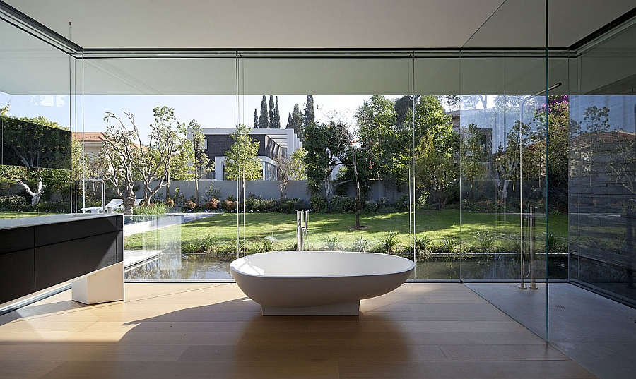 White standalone tub in the expansive contemporary bathroom