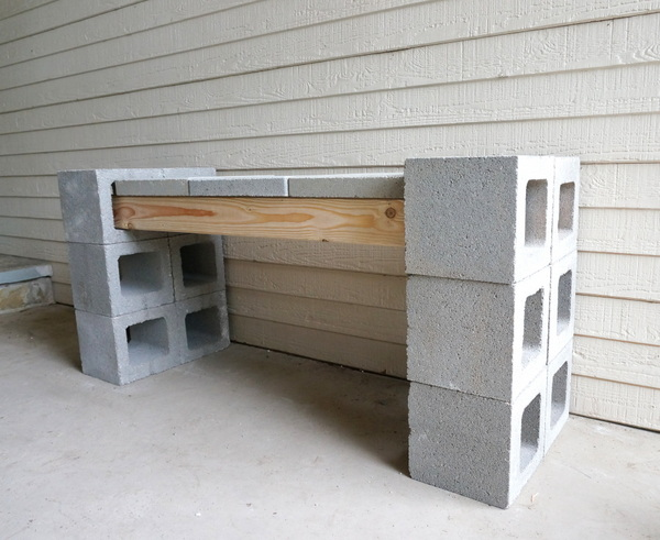 Wood, cinder blocks and pavers form a sturdy bench