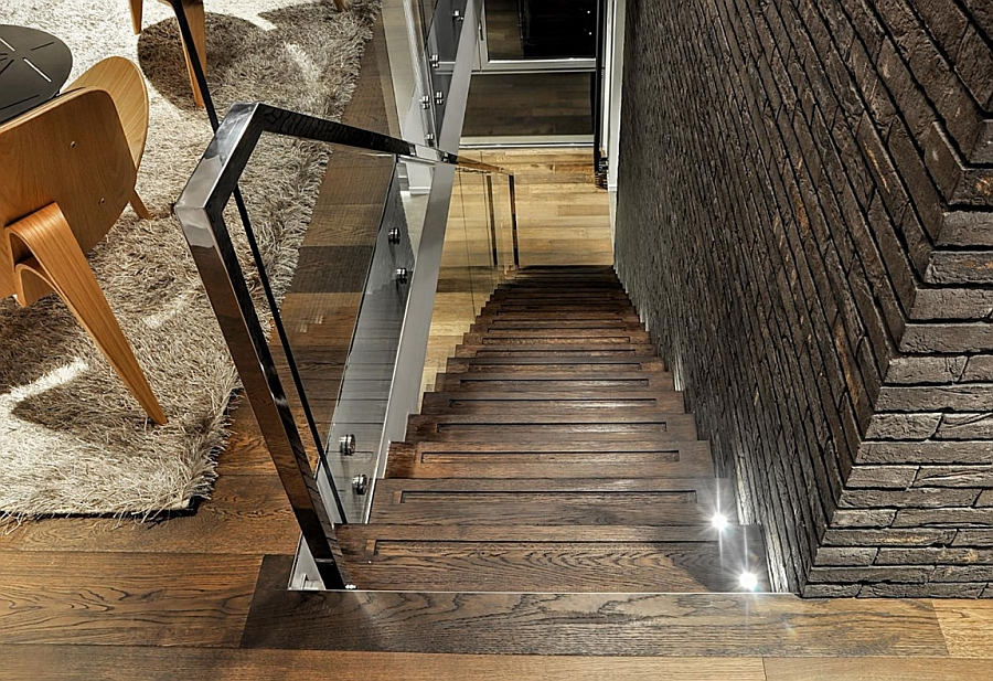 Wooden staircase with a glass railing
