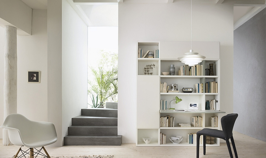 A built-in workstation and reading space in the living room wall unit