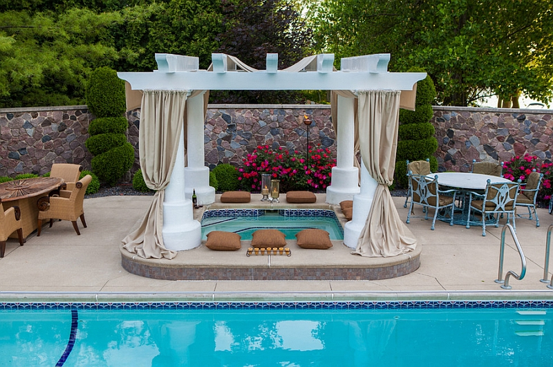 A fabulous outdoor space promises a soothing dip in the hot tub by the pool