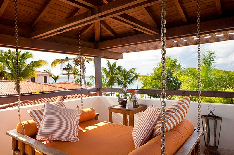 A hanging outdoor daybed for the tropical patio
