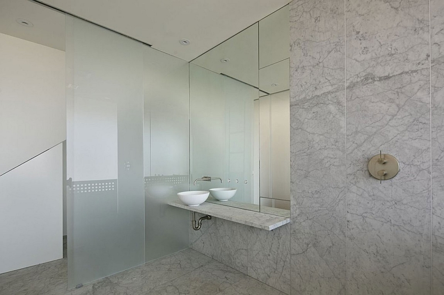 A minimal bathroom with frosted glass doors