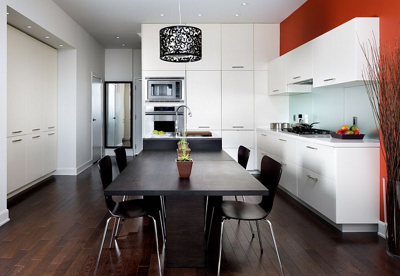 A pop of orange in the black and white kitchen