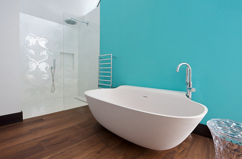 A refreshing touch of aqua turns the white standalone tub into a focal point!