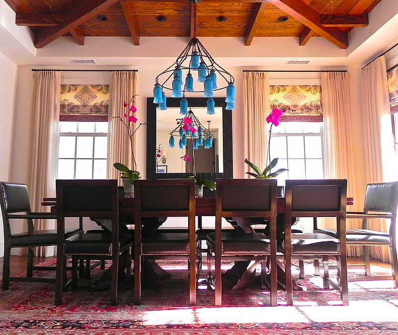 A wonderful use of bright fuchsia and turquoise in the dining space