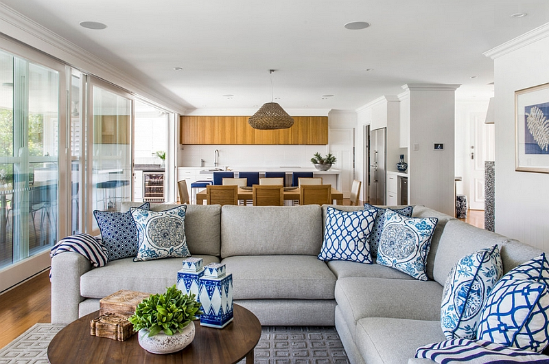 Accent pillows and ceramics are a classic way to bring the blue and white color scheme to the living room