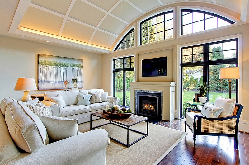 Ambient lighting plays a major role in the living room with TV above fireplace