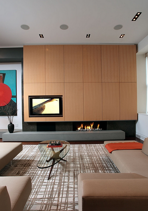 An artistic touch to the fireplace and TV combo!