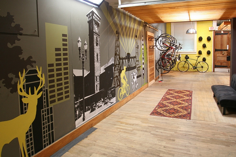 An industrial style entry with a bike rack, barn door and an attractive wall mural