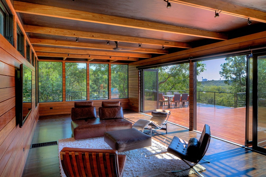An interior that is seamlessly connected with the expansive wooden deck outside
