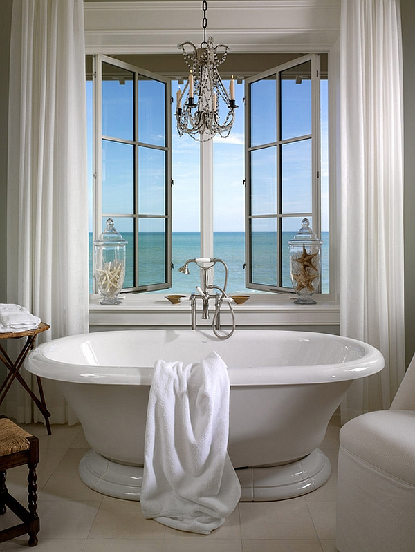 Apothecary jars with starfish add to the beach style of the bathroom