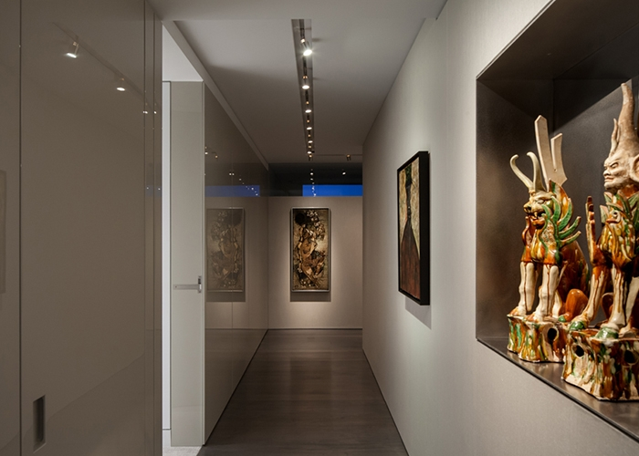 Asian art collection in the corridor