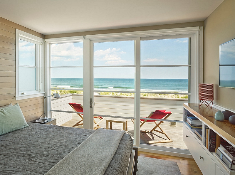 Beach style bedroom with cool sliding doors