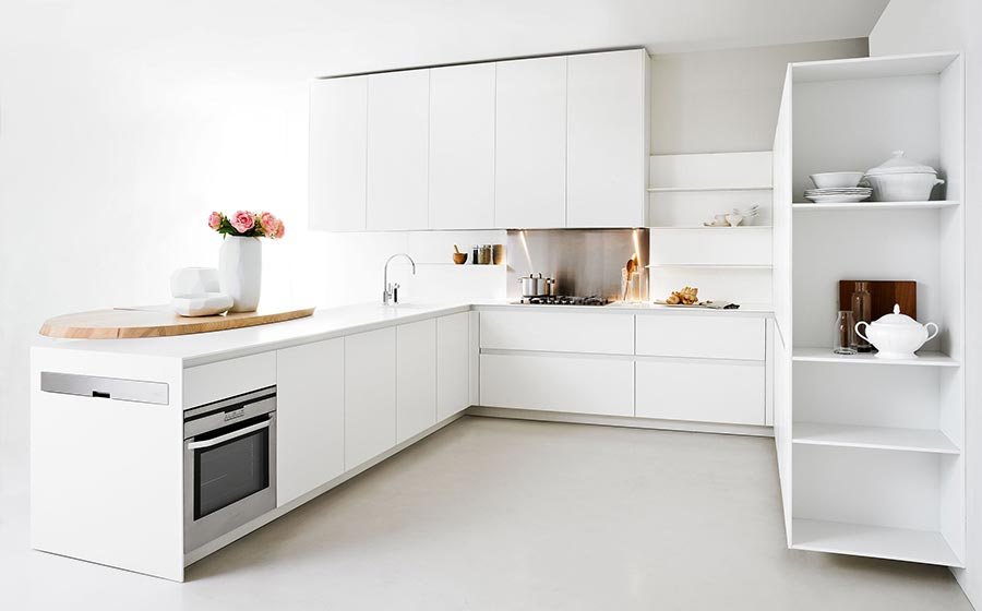 Beautiful all-white, minimalist kitchen for the small urban apartment