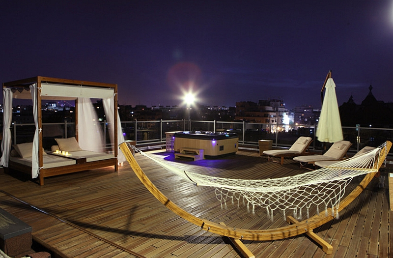 Beautiful terrace overlooking Bucharest with an outdoor bed and a hammock