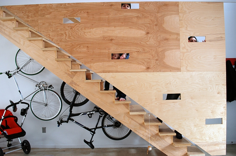 Bike rack uses the space under the unique flight of plywood stairs to the hilt