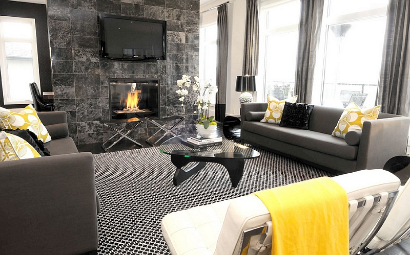 Black and white interior with yellow accents and TV mounted above the fireplace