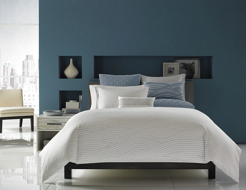 Blue with a hint of grey along with white give the bedroom a sophisticated look