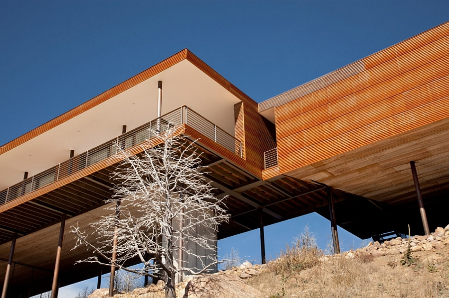 Cantilevered Mountain home with a wooden exterior Majestic Mountain Views And Untamed Elements Shape The Fourmile Sky House
