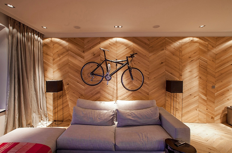 Chevron wall offers the perfect backdrop for the wall-mounted bike