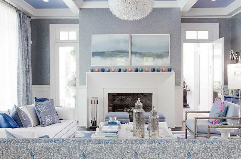 Classy contemporary living room uses subtle shades of blue with white