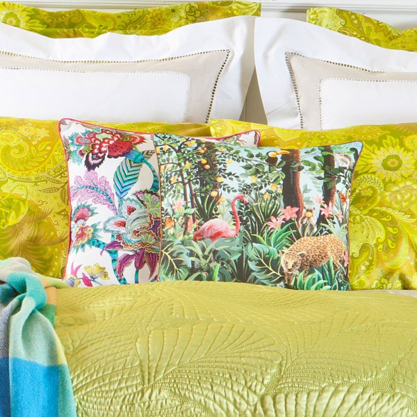 Colorful jungle-themed pillow